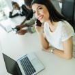 Businesswoman talking on mobile phone — Stock Photo #78746426