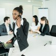 Businesswoman at office meeting — Stock Photo #78749026