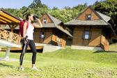 Tourist hiking and using binoculars — Stock Photo