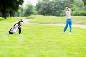 Golfer practicing and concentrating before and after shot — Stock Photo