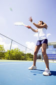 Female tennis player in action — Stock Photo