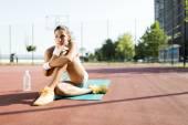 Sportswoman taking a break — Stock Photo