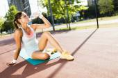 Woman drinking water after exercise — Stock Photo