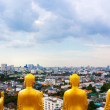 View on city from temple with Buddha statues — Stock Photo #78677936