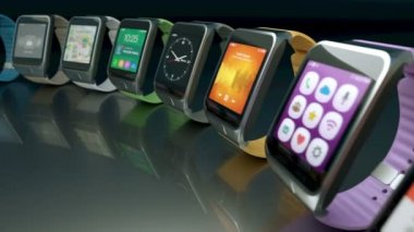 Multiple smart watches moving in a circle — Stock Video
