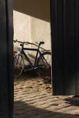 Bicycle Behind an Open Gate — Stock Photo
