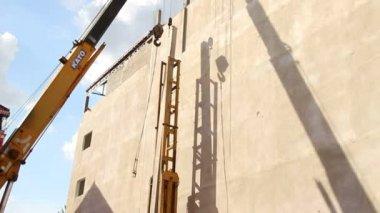 SIEAM REAP, CAMBODIA - CIRCA JULY 2015: Crane Lowers Concrete Pile into Piledriver — Stock Video