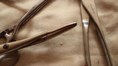 Macro Close Up Dolly  Across Vintage Surgical Medical Geat - Jumble of INstruments — Stock Video