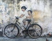Street Mural tittle 'Little Children on a Bicycle'ark, street art, decoration, paint, wall paper, background, bicycle, kid, Penang, Malaysia — Stock Photo