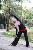 Muslim girl is stretching — Stock Photo