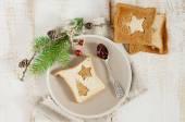 Chrismas breakfast. Spoon berry jam and slice toast bread on woo — Stock Photo