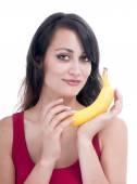 Pretty woman with banana — Stock Photo
