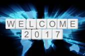 Мире свечение фон и клавиатуры Кнопка с словом приветствовать 2017 — Стоковое фото