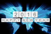 Världen glöd bakgrund och tangentbord knappen med ordet 2016 glad n — Stockfoto