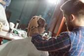 Shaving process in barber shop — Stock Photo