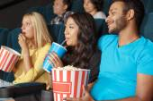Young couple at the movie theatre — Stock Photo