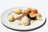 Close up of fried salmon with spinach,boiled potatoes and cream — Stock Photo