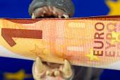 10 Euro note in mouth of a hippo figurine — Stock Photo
