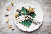 Christmas place setting, plate, napkin, knive and fork — Stock Photo