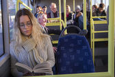 Woman reading on the bus — Stock Photo
