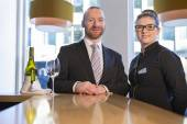 Bar staff smiling for the camera — Stock Photo