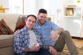 Same sex couple smiling together for camera in their home — Stock Photo