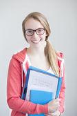 Portrait of teenage girl with school work — Stock Photo