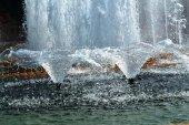Spurting fountain spray — Stock Photo