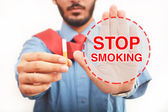 Professional Quit smoking sign Throwing Away cigarette — Stock Photo
