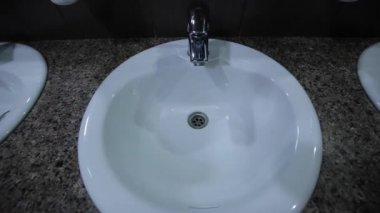 A man approaches the tap opens the tap, the water begins to flow, hand washing — Stock Video