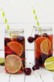 Summer refreshing homemade lemonade with cherry and lime — Stock Photo