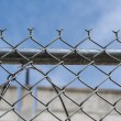Wire fence for protection and safety under blue sky — Stock Photo #81308822