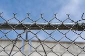 Wire fence for protection and safety under blue sky — Stock Photo