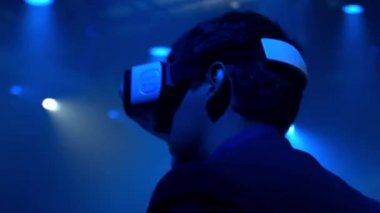 Young man using Oculus Rift Virtual Reality glasses at Alexandrian Theater show Saint-Petersburg 31.07.2015 — Stock Video