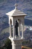 Statue of saint on top of the mountain, San Marino — Stock Photo