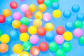 Colored balls floating in kiddie pool — Stock Photo