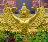 Golden garuda statue under the picture frame — Stock Photo