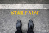 Shoes standing at start now line — Stock Photo
