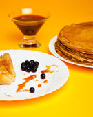 Russian taste pancakes with black currant — Stock Photo