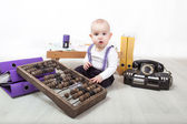 Child boy playing with abacus — Stock Photo