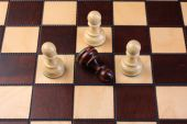Chess pieces on a chess board — Stock Photo