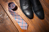 Leather footwear and a checkered tie — Stock Photo