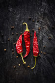 Hot red pepper and black pepper — Stock Photo