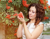 Portrait of young woman with rowan — Stock Photo