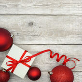 Christmas Present and Baubles — Stock Photo