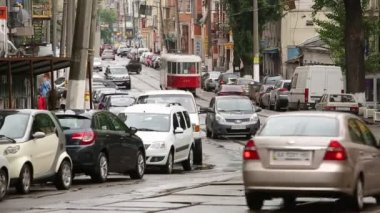 Kiev, Ukraine - May 15, 2014. Vehicular traffic on tramways — Stock Video