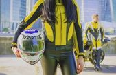 Woman in motorcycle suit with helmet — Stock Photo