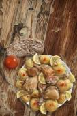 Plate of Fried Chicken Legs with Potato and Lemon Slices Bread and Tomato on Old Wooden Table — Stock Photo
