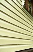 Wall of the house with light color siding at close range — Stock Photo
