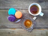 Cup of coffee with colorful macaroons — Stock Photo